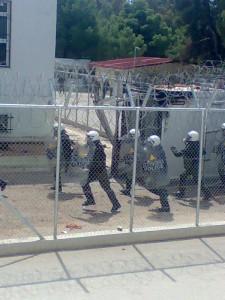 Riot police entering Corinth detention centre