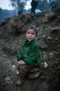 Barefoot in the rain a small Afghan boy is waiting in the queue for days / copyright: Salinia Stroux