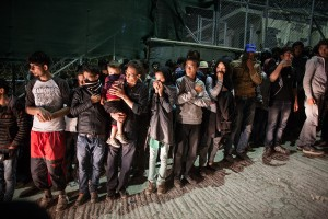 Refugees trying to protect themselves from the tear gas / copyright: Salinia Stroux
